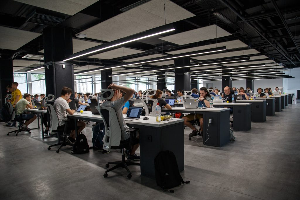 Employees working at desks in open plan office