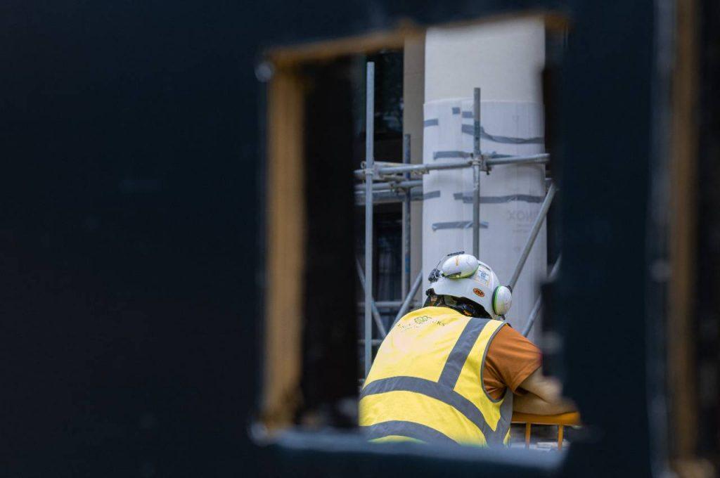 man in hi vis working on constructin site